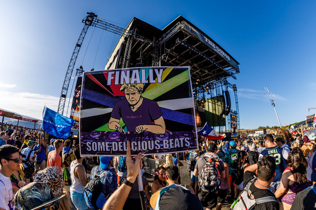 Finally some delicious beats meme held above crowd